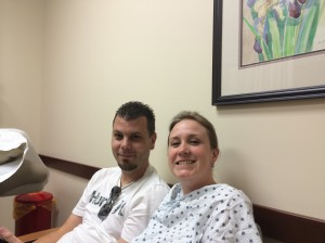 Mike and I waiting for the CT results. We look sooo excited. My dad took the photo.